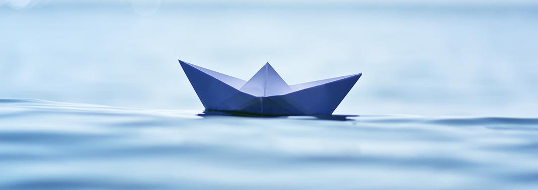 Blue Paper boat floating